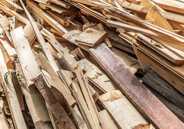 Heap of construction wooden debris close-up.