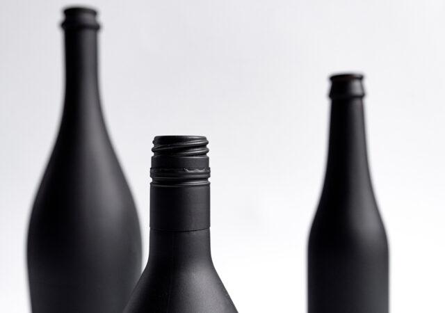 Black bottles Mock-Up – Image. Closeup